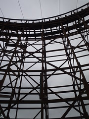 Wooden Rollercoaster against dark cloudy sky (Eric Broder Van Dyke) Tags: park carnival summer vacation people motion clouds speed dark circle fun amusement wooden ride swings fast blurred fair structure entertainment roller leisure around rollercoaster activity excitement greatamerica coaster themepark amusementride