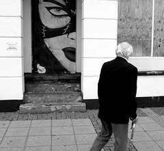 Weather Dull with a chance of rain - hidden gems (Claire_Sambrook) Tags: people bw streetart art walking candid creative rangefinder portsmouth southsea x100 southseaseafront fujix100