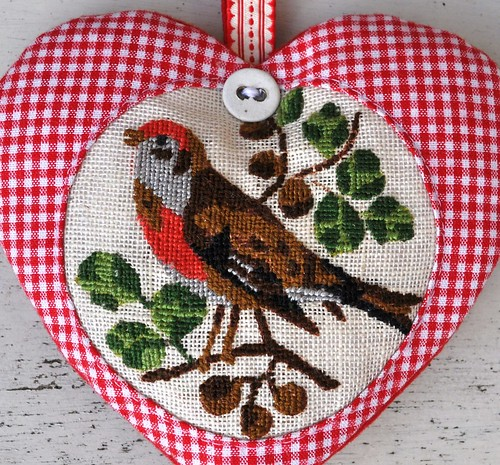 heart with embroidered bird
