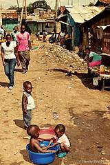 Kids bathing (HennyBoogert) Tags: poverty africa street travel portrait people kids canon photography photo kenya nairobi homeless poor picture streetphotog