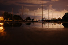 City Reflected in a Puddle (Seth Oliver Photographic Art) Tags: nightphotography chicago building clouds reflections iso200 illinois nikon midwest nightlights skyscrapers searstower cities cityscapes lakemichigan nightshots trumptower montroseharbor pinoy johnhancockbuilding nightscapes chicagoskyline urbanscapes secondcity windycity longexposures chicagoist cityskylines urbannightshots d90 nightexposures 10secondexposure wetreflections lakepointetower cityofchicago cityofbigshoulders sooc aperturef63 willistower uptownneighborhood setholiver1 18105mmnikkorlens camerasetto10seconddelay camerasetonground