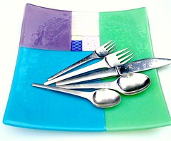 Square colored glass dinner plate by RoseAmbr, with a setting of mid-century modern Jensen silverware