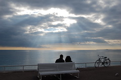 (brittanyee) Tags: sun france beach water clouds nice couple halo beams nikond40