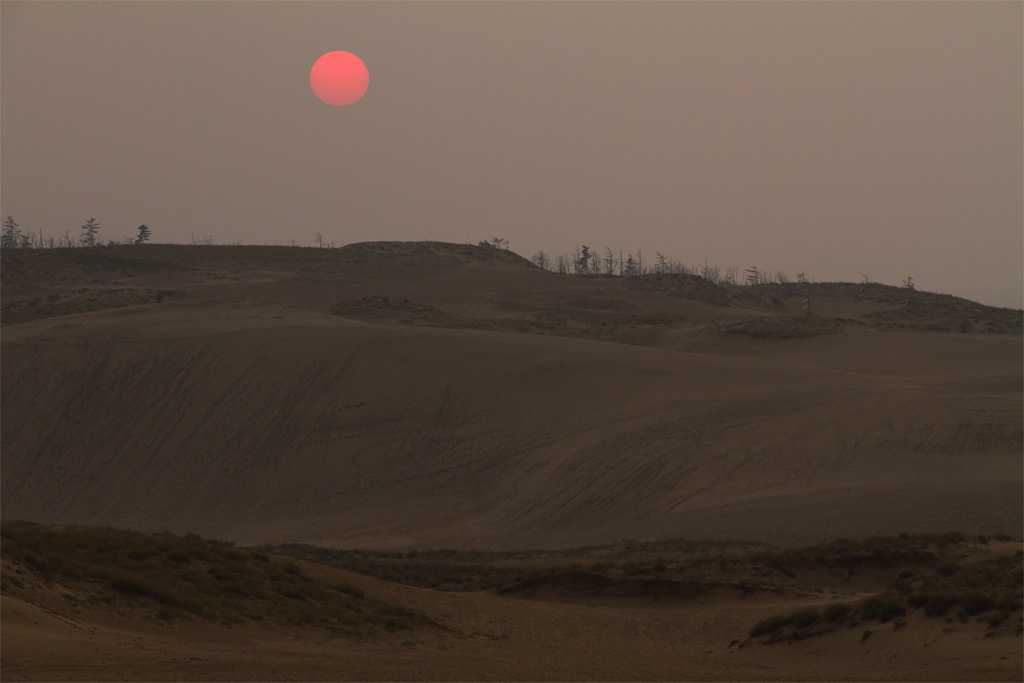 the sunset in sand dunes