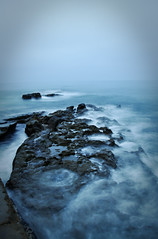 Movement against still (coolgirljkuo) Tags: ocean california ca sea water rock cali la rocks long exposure waves pacific cove calif jolla