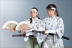 Two young woman dancing with katana and fan (Dmitry Mordolff) Tags: two portrait woman white beautiful beauty face sport japan female standing studio asian person japanese one fan dance costume clothing fight movement women looking ninja traditional attack arts young culture posing sharp east human weapon sword warrior kimono samurai accessories blade brunette katana fighting sensuality adults elegance ceremonial kenbu