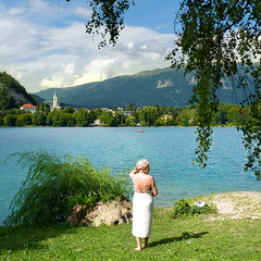 Bathing in the beneficial waters of Lake Bled (Bn) Tags: world travel blue girls summer two woman sun mountain lake holiday alps castle feet water pool beauty swimming swim geotagged island swan topf50 women hiking relaxing ducks tourist medieval romance slovenia alpine bled rowing romantic championships relaxation picturesque idyllic thermal attraction kasteel wellness slopes barna glacial eldery overwhelming 2011 blejski 50faves pletna veldes geo:lon=14103817 geo:lat=463640