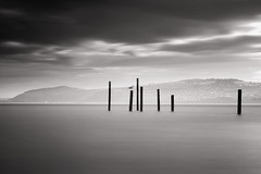 Three Less (Anthony Owen-Jones) Tags: ocean uk longexposure sea blackandwhite bw cloud seascape black beach water monochrome wales clouds lens landscape eos rebel mono bay coast landscapes photo seaside kiss long exposure unitedkingdom jetty horizon picture gimp minimal hills filter photograph ethereal nd kit split postprocess tone minimalist bnw conwy t3i x5 rhosonsea colwynbay northwales rhos colwyn 600d takenwith 10stop nd110 canonefs1855mmf3556is rebelt3i kissx5