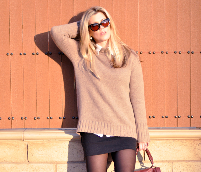 cashmere sweater - collar peeking  out-mini skirt-black tights-cat eye sunglasses