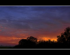Every evening should be like this (Wim Koopman) Tags: blue sunset red sky orange sun holland color colour tree netherlands dutch silhouette set clouds canon photography evening countryside photo afternoon country stock nederland powershot late friesland stockphoto s90 stockphotography s100 kubaard wpk s95