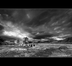 Eilean Donan Castle (Kit Downey) Tags: uk bridge summer bw white storm black castle rain clouds canon lens landscape outside outdoors eos rebel scotland europe angle wide dramatic scottish super tokina kit iconic eilean donan 2009 f28 cliche downey dornie jacobite xti 400d 1116mm