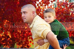 Father and Son (Rebecca812) Tags: family autumn boy portrait orange man color tree cute green fall love nature leaves yellow togetherness kid dad child sweet father son strong protection piggyback enjoyment bonding oneparent canon5dmarkii rebecca812 gettyimagesportrait heritage2011