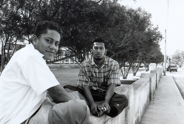 Tongan Boys Sitting on Ledge