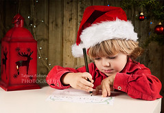 (tchara) Tags: christmas wood old winter red portrait holiday cute male home beautiful smile closeup pen pencil photography gold lights kid waiting child looking bright bokeh furniture room decoration christmastree note round surprise letter write jolly littleboy santahat bauble decorate oldwood oneperson smilling decorated caucasian lifestyles expectation faceexpression sheetofpaper childrenonly colourimage elementaryage