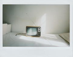 The TV is on but the colors are gone ((_)...) Tags: light white film polaroid tv bed fuji wide explore instantcamera instax 210