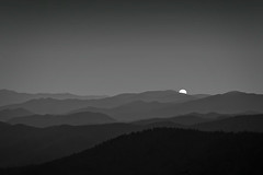 Fading (James Duckworth) Tags: sunset sky blackandwhite sun mountains monochrome high view northcarolina valley tops hilltop greatsmokymountains mountaintop appalachianmountains appalachians layered greatsmokymountainsnationalpark gsmnp gowestyoungman pprowinner