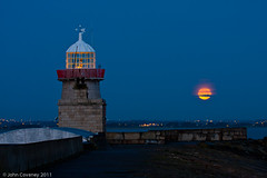Moonset at Howth - EXPLORED! (John Coveney Photos) Tags: ireland howth moon lighthouse gold dawn pier fullmoon bluehour moonset flickrexplore codublin explored johncoveney