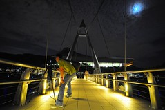 In Action! (Trim Reaper) Tags: bridge moon night clouds nikon singapore photographer suspension action tokina cris footpath in d90 tanjongrhu singaporeindoorstadium 1116mm gandionco