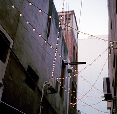 From the night before (Brendan_Timmons) Tags: hasselblad500c carlzeissplanar80mmf28 120 6x6 newkodakportra400 alley lights fairy night string cross