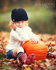 pumpkin pout (jaki good miller) Tags: portrait childhood interestingness adorable explore littlegirl exploreinterestingness jakigood childportrait top500 explored naturallightportrait adorablelittlegirl autumnportrait littlegirlwithpumpkin littlegirlwithredcurlyhair blackcrochethat portraitwithpumpkin