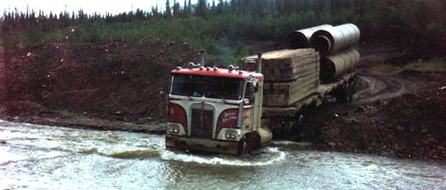 BC truck driver navigates a mountain creek with big tractor trailer