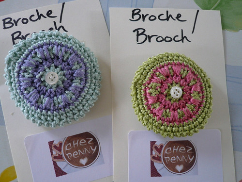 Boss brooches