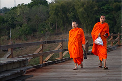 Monks on the Bridge (Ursula in Aus (Away)) Tags: wood bridge man male thailand village buddhist monk buddhism mon kanchanaburi  sangkhlaburi   earthasia totallythailand   luangphouttamamemorialbridge khaolaemreservoir