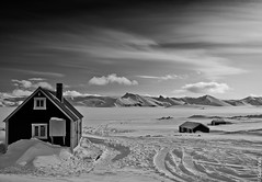 (Explore)Jkulheimar are situated in an area called Tungnarbotnar near the edge of the glacier snout Tungnarjokull. (Gulli Vals) Tags: travel winter light sky blackandwhite cliff sunlight white house snow black mountains cold ice nature clouds landscape island frozen iceland europe day hike glacier freeze snowing traveling scandinavia snout nttra icebergs vatnajkull landslag jkulheimar kofar gullivals tungrbotnar