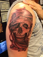 Skull with an army helmet tattoo by Wes Fortier