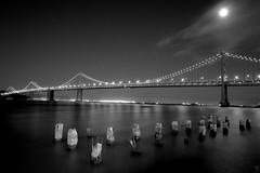 Bay bridge (.Vijay) Tags: sanfrancisco california longexposure nightphotography bridge moon blackwhite nikon baybridge embarcadero bayarea 24mm nikkor southbeach 2011 d700 nikon1424mmf28afsgedn