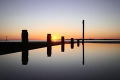 Reflect (Kip) Tags: sunset sea reflection beach water groin