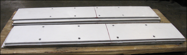 PTFE, 25% glass filled slide plates bonded to stainless steel backing plates