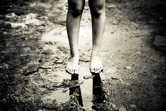 left and broken (bbabyshambles) Tags: blackandwhite bw feet water monochrome puddle sad legs knees