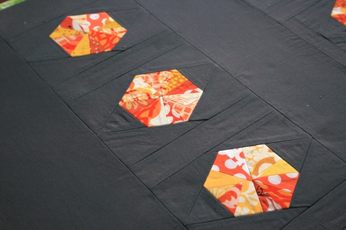 gray and orange scrap quilt