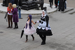 A helping hand (lightfran) Tags: pink costumes white black london comics fun purple cosplay comicbookheroes skirt convention comicbook holdinghands comiccon fancydress excel roleplay excelexhibitioncentre londoncomiccon londoncomiccon2011