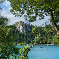 Bled Castle is the oldest castle in Slovenia (Bn) Tags: travel blue trees girls summer two mountain lake holiday alps green castle feet water swim geotagged island swan topf50 women day cloudy hiking relaxing ducks tourist medieval romance slovenia alpine frame bled romantic picturesque topf100 idyllic kasteel slopes barna glacial blejski 100faves 50faves pletna geo:lon=14104167 geo:lat=46364110
