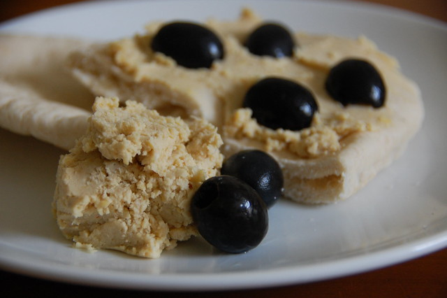 Hummus on pitta bread with Olives