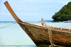 Traditional Thai Boat .. Ready to go! (Meshari Al-Rezaihan) Tags: sea sky green water canon thailand boats island islands boat southeastasia bluesky atthebeach phuket watercraft longtailboat greentrees 550d meshari lens18200mm canon550d eos550d alrezaihan traditionalthaiboats