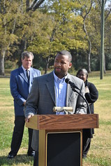 Councilman Lonnell Matthews talks to neighbors about the improvements to the park and area sidewalks