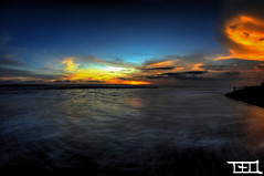 where the sun embraces the sun (Teo Morabito) Tags: ocean blue light sunset red sea bali orange sun fish eye art texture beach wet water beautiful set dark indonesia landscape photography photo movement aperture colorful long exposure small great atmosphere villa lovely powerful hdr morabito justclouds berawa photosteomorabitocom wwwphotosteomorabitocom wwwteomorabitocom teomorabito