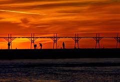 Fishing by the firelight - Explored (Notkalvin) Tags: sunset fish beach pier fishing fishermen michigan explore lakeshore manistee northpier flickrexplore explored notkalvin