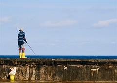 Havana Yellow (Lou Morgan) Tags: latinamerica yellow america bucket fishing fisherman boots havana cuba latin malecon habana wellies wellingtons