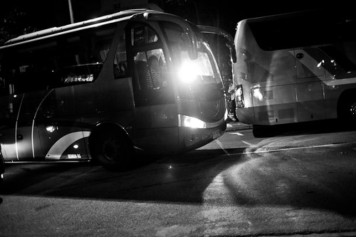 A bus turning into the narrow road to ferry foreign workers back to their hostels / apartments.