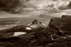 Cleat Illuminated (Paul Newcombe) Tags: uk blackandwhite bw storm mountains tourism monochrome walking landscape scotland countryside moody view isleofskye cloudy hiking north kitlens scottish hills vista british 1855 cleat sotland splittoned quiraing splittoning dundubh druimanruma lochcleat lochleumnkluuirginn frommaoladhmor 336metres