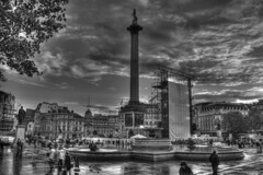 Trafalgar Square - Vienna (Jonathan.Russell) Tags: vienna sky people white storm black tree tower wet fountain rain statue clouds canon square cool flag awesome dramatic trafalgar nelson column posh slippery 1920 multiculturalism 40d