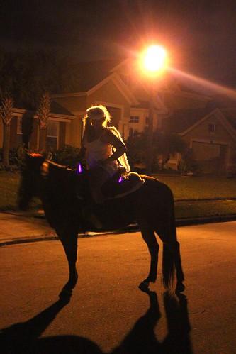 Trick-or-treater on horseback