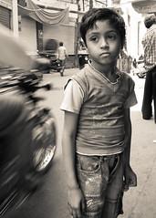 Somewhere else. (Nina Matzat) Tags: life street travel boy people blackandwhite bw india cute bike kids nikon child indian dream menschen dreaming motorbike leben rajasthan junge jodhpur motorrad abwesend trumen strase d5000