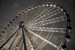 Big Wheel in Manchester (revisited) (Sylvain Francois) Tags: park carnival england wheel sepia manchester amusement ride fairground dramatic fair ferris 1750 bigwheel tamron funfair attraction gondolas northwestengland