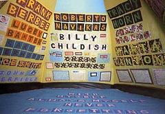 people's names on three walls and the floor--they appear to be out of cut paper