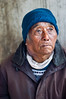 Eyes of Truth (Apratim Saha) Tags: old blue portrait people brown india white man west eye up vertical shirt scarf outside outdoors pain exterior adult indian gray oldman tibet monastery jacket cap elderly bengal nationalgeographic kalimpong westbengal siliguri graying apratim apratimsaha zangdhokpalriphodang apratimsahacom durphinhill